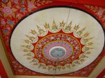 Beautiful ceiling about a collection of Buddha statues