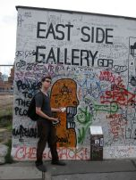 Eric channels Vanna White at the East Side Gallery