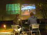 Old school games projected onto walls of buildings