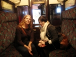 Mom and I testing the seats in an old subway car.